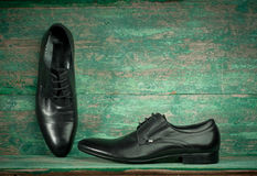 Fashion concept with male shoes on wooden Royalty Free Stock Images