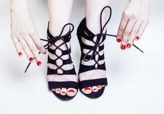 Fashion concept people: woman with red nails manicure pedicure t Royalty Free Stock Photography