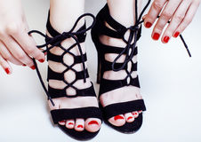 Fashion concept people: woman with red nails manicure pedicure t Stock Images
