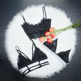 Fashion concept. Three lace bustier on a white fur. Top view.  stock photos