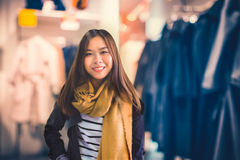 Fashion concept - Young Confident woman in clothing store. Royalty Free Stock Photo