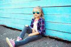 Fashion cool child wearing a sunglasses and checkered shirt Royalty Free Stock Image