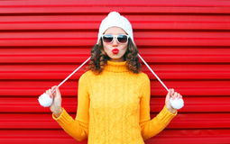Fashion cool girl blowing red lips makes air kiss Royalty Free Stock Images