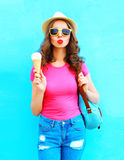 Fashion cool young woman with ice cream over colorful blue Royalty Free Stock Photography