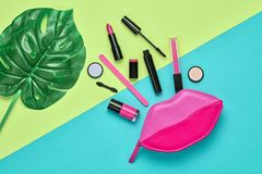 Fashion Cosmetic Makeup Set. Beauty Essentials. Fashion Cosmetic Makeup Minimal Set. Creative Essentials. Trendy Design Pink Clutch Bag, tropical leaf. Woman Stock Images