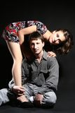 Fashion couple. Man and woman. Beautiful couple on a black background Royalty Free Stock Photo