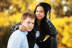 Fashion couple against an autumn nature background Royalty Free Stock Photography
