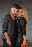 Fashion couple in black leather royalty free stock images