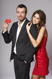 Fashion couple with blank credit card Stock Photo