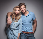 Fashion couple in casual clothes standing embraced Stock Photo