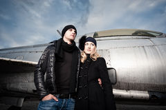 Fashion Couple and Fighter Plane Royalty Free Stock Photo