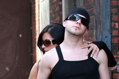 Fashion couple hugging. Fashion couple outside wearing sunglasses royalty free stock photo