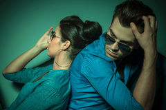 Fashion couple leaning on each other Stock Photo