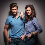 Fashion couple leaning on a grey wal Stock Photography