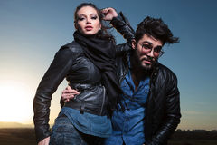 Fashion couple in leather clothes posing outdoor Royalty Free Stock Image