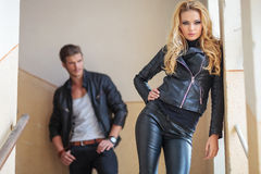 Fashion couple in leather clothes posing Stock Photography