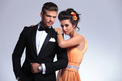 Fashion couple looking into the camera Royalty Free Stock Image
