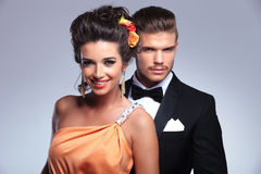Fashion couple with man behind, smiling royalty free stock photos