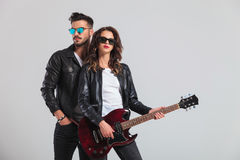 Fashion couple playing electric guitar Stock Photo