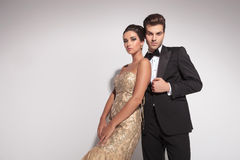 Fashion couple posing against studio background Royalty Free Stock Images