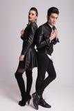 Fashion couple posing back to back Royalty Free Stock Images