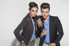Fashion couple posing close to each other Stock Photos