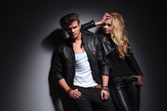 Fashion couple posing on grey studio background Royalty Free Stock Photography