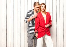 Fashion couple posing in the studio, Vogue style. Guy with a girl posing in the studio near the window, Vogue style Stock Image