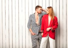 Fashion couple posing in the studio, Vogue style. Guy with a girl posing in the studio near the window, Vogue style Royalty Free Stock Photos