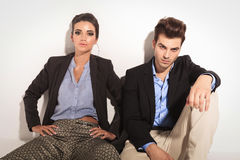 Fashion couple sitting on the floor Stock Image