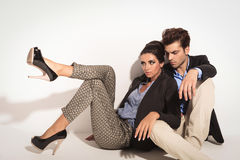 Fashion couple sitting on the floor together Stock Photo