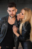 Fashion couple smoking cigarette Royalty Free Stock Image