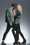 Fashion couple standing face to face Stock Images