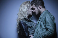 Fashion couple standing face to face. Young embraced fashion couple standing face to face Stock Photography