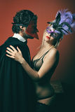 Fashion couple wearing venetian masks Stock Photography