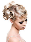 Fashion creative hairstyle. For young beautiful blond woman - isolated on white stock photos