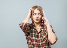Girl with phone Stock Photography