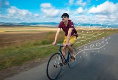 Fashion cyclist in the nature going somewhere. Fashion person riding bicycle in the nature with doodle concept Stock Photography