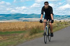 Fashion cyclist in the nature going somewhere. Fashion person riding bicycle in the nature with doodle concept royalty free stock photo