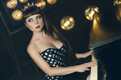 Fashion dark princess with a crown Royalty Free Stock Images