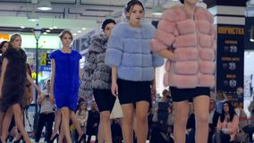 Fashion Defile show, Stylish Fur coats On models Going on catwalk, presentation of new collection of winter clothing