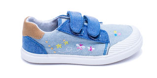 Fashion denim baby shoes for the toddlers feet. Kids sneakers isolated on white background. Royalty Free Stock Images