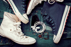 Fashion denim shoes and gadgets Stock Images
