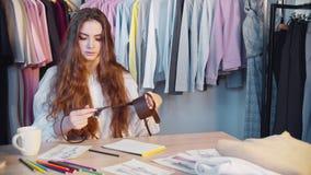 Fashion design female stylist working waist belt
