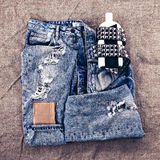 Fashion design photos. Metal grunge style. Vintage blue jeans Royalty Free Stock Photos