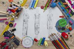 Fashion Design sketch - dressmaker Table. Shoot of the Fashion Design sketch - dressmaker Table royalty free stock images