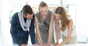 Fashion design team looking at costume jewelry Royalty Free Stock Photography