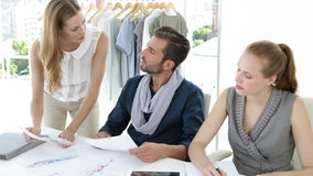 Fashion design team working together at table stock footage