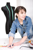 Fashion designer. Young adult fashion designer at work Royalty Free Stock Photography