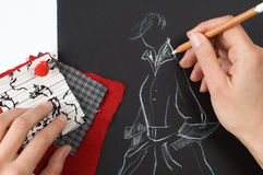 Fashion designer. Is drawing a fashion model Royalty Free Stock Photo